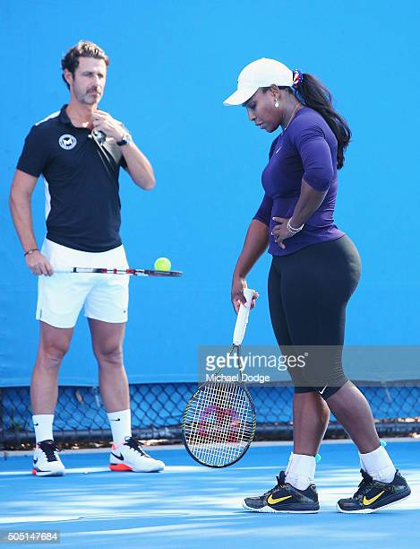 Serena Williams of the USA appears to be in discomfort next to coach Patrick Mouratoglou and leaves the court shortly after during a practice session...