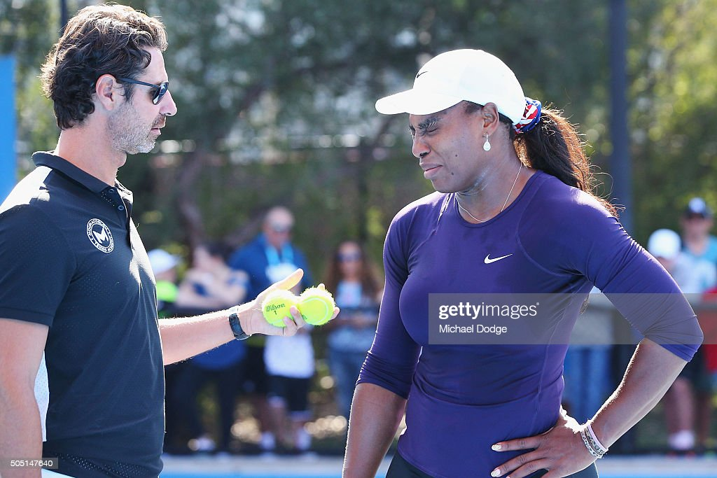Serena Williams of the USA appears to grimace in discomfort next to coach Patrick Mouratoglou and leaves the court moments later during a practice session ahead of the 2016 Australian Open at Melbourne Park on January 16, 2016 in Melbourne, Australia.