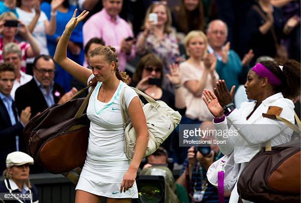 Serena Williams of the USA applauds Petra Kvitova of the Czech Republic after defeating her in their Ladies' Singles quarterfinal match on day eight...