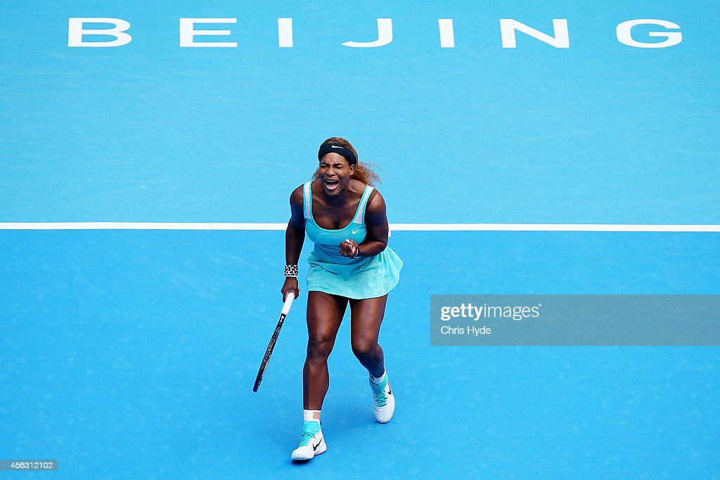 Serena Williams of the USA celebrates a point in her match against Silvia Soler-Espinosa of Spain during day three of the China Open at the China National Tennis Center on September 29, 2014 in Beijing, China.