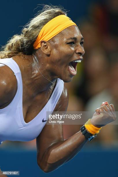 Serena Williams of the USA celebrates a point in her match against Maria Sharapova of Russia during day six of the 2014 Brisbane International at...
