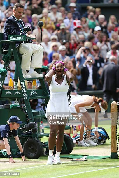 Serena Williams of the USA celebrates after her Ladies' Singles final match against Agnieszka Radwanska of Poland on day twelve of the Wimbledon Lawn...