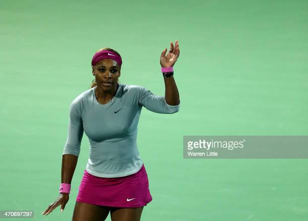 Serena Williams of the USA celebrates beating Jelena Jankovic of Serbia during day four of the WTA Dubai Duty Free Tennis Championships at the Dubai...