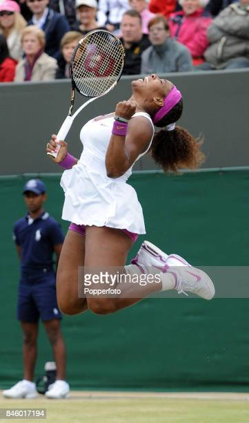 Serena Williams of the USA celebrates her fourth round victory over Yaroslava Shvedova of Kazakhstan on Day Seven of the Wimbledon Lawn Tennis...