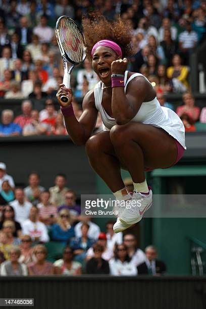 Serena Williams of the USA celebrates match point during her Ladies' Singles third round match against Jie Zheng of China on day six of the Wimbledon...