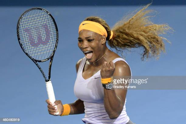 Serena Williams of the USA celebrates victory after her finals match against Victoria Azarenka of Belarusduring day seven of the 2014 Brisbane...