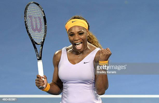 Serena Williams of the USA celebrates victory after her finals match against Victoria Azarenka of Belarus during day seven of the 2014 Brisbane...