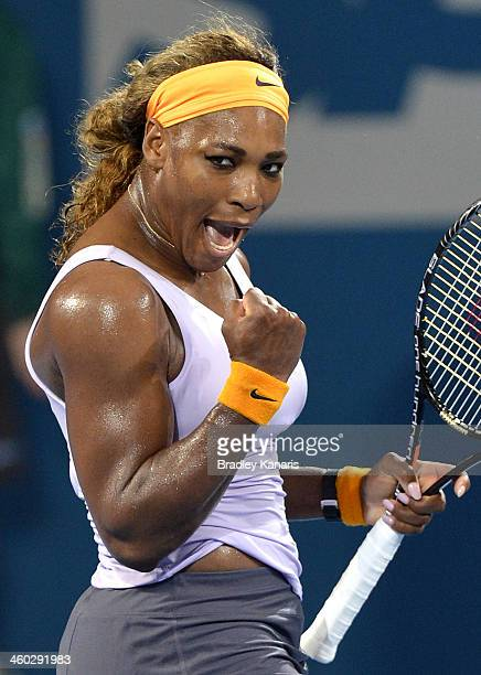 Serena Williams of the USA celebrates victory after her match against Maria Sharapova of Russia during day six of the 2014 Brisbane International at...