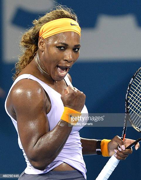 Serena Williams of the USA celebrates victory after her semi final match against Maria Sharapova of Russia during day six of the 2014 Brisbane...
