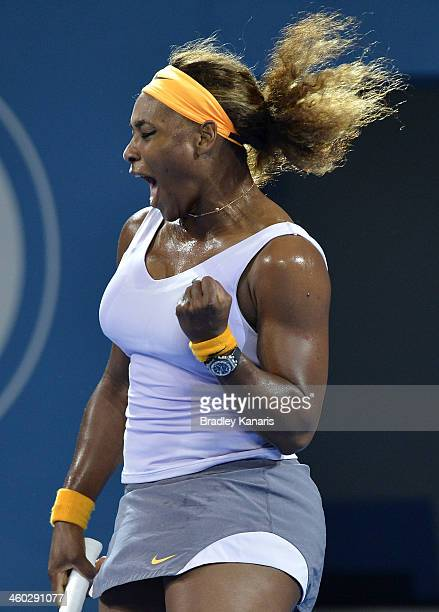 Serena Williams of the USA celebrates winning a point in her match against Maria Sharapova of Russia during day six of the 2014 Brisbane...
