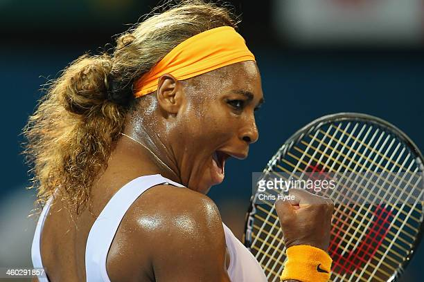 Serena Williams of the USA celebrates winning her match against Maria Sharapova of Russia during day six of the 2014 Brisbane International at...