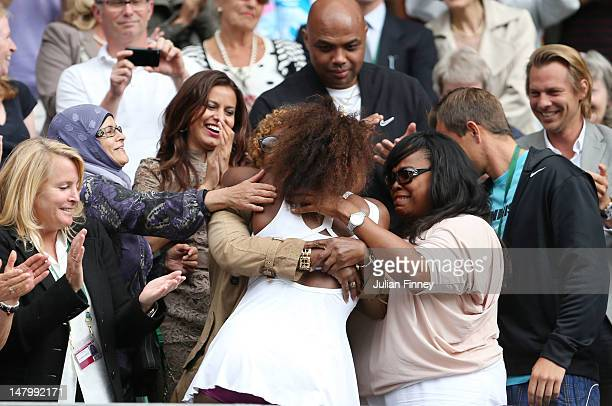 Serena Williams of the USA celebrates with her mother Oracene Price after her Ladies' Singles final match against Agnieszka Radwanska of Poland on...