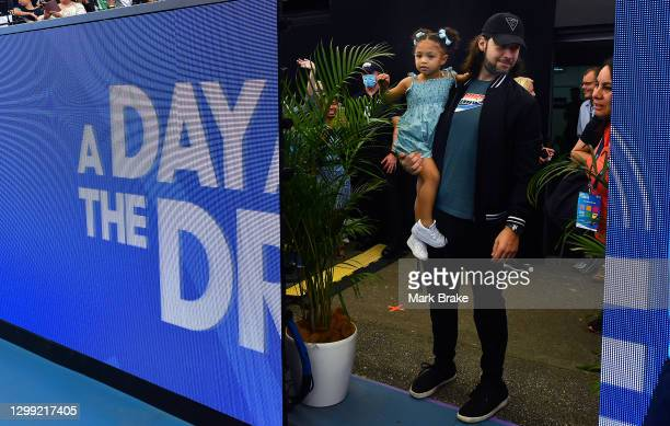 Serena Williams of the USA daughter Alexis Olympia Ohanian Jr waits with dad Alexis Ohanian during the 'A Day at the Drive' exhibition tournament at...