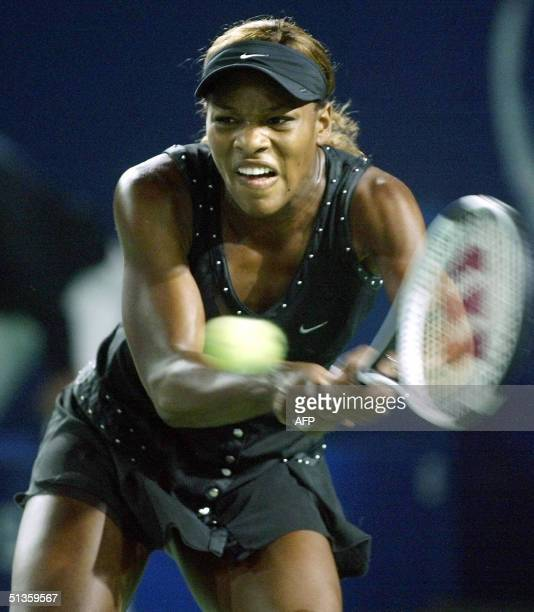 Serena Williams of the USA hits a backhand return to Svetlana Kuznetsova of Russia in the third set of the inaugural China Open women's final 26...