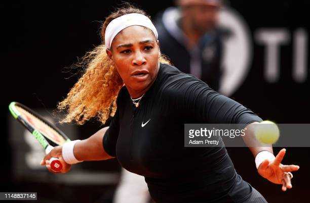 Serena Williams of the USA hits a forehand during her first round match agains Rebecca Petersen of Sweden during day two of the International BNL...