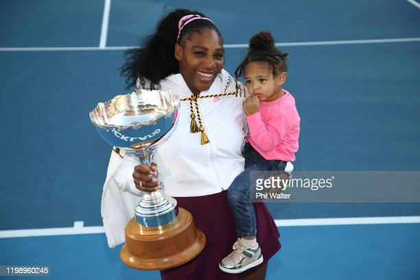 Serena Williams of the USA holds her daughter Alexis Olympia with the trophy following the Women's Final between Serena Williams and Jessica Pegula...