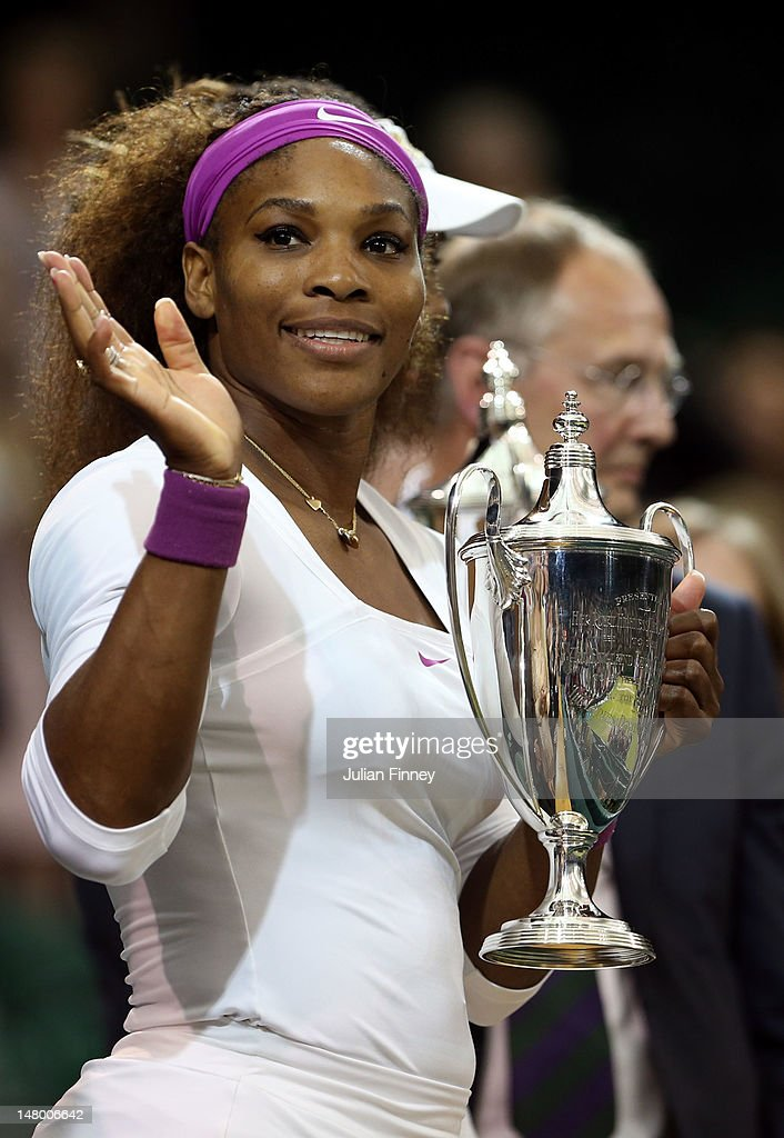 Serena Williams of the USA holds her winners trophy after her Ladies' Doubles final match against Andrea Hlavackova and Lucie Hradecka of the Czech Republic on day twelve of the Wimbledon Lawn Tennis Championships at the All England Lawn Tennis and Croquet Club on July 7, 2012 in London, England.