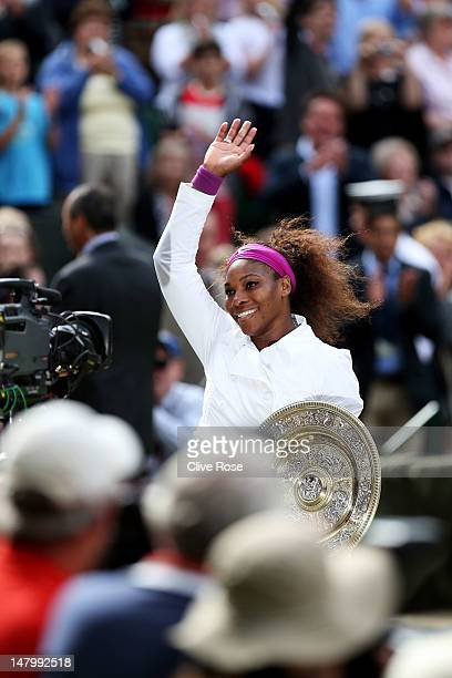Serena Williams of the USA holds the winners trophy and celebrates after her Ladies' Singles final match against Agnieszka Radwanska of Poland on day...