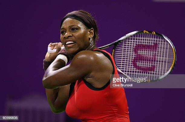 Serena Williams of the USA in action against Venus Williams of the USA in the Women's final during the Sony Ericsson Championships at the Khalifa...