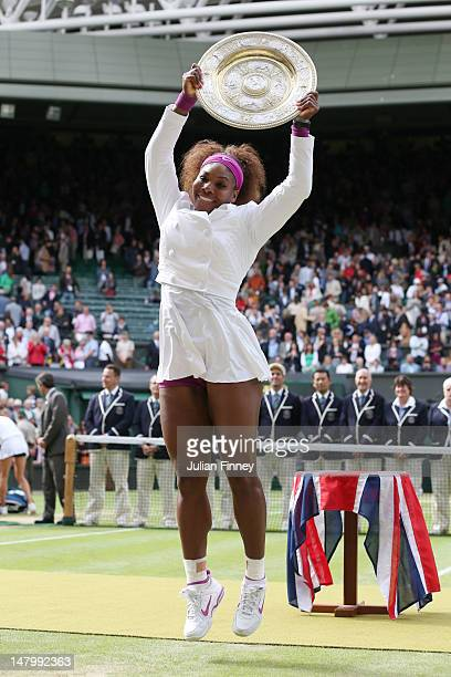 Serena Williams of the USA jumps in the air with the winners trophy and celebrates after her Ladies' Singles final match against Agnieszka Radwanska...