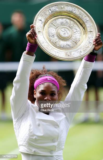 Serena Williams of the USA lifts the winners trophy and celebrates after her Ladies' Singles final match against Agnieszka Radwanska of Poland on day...
