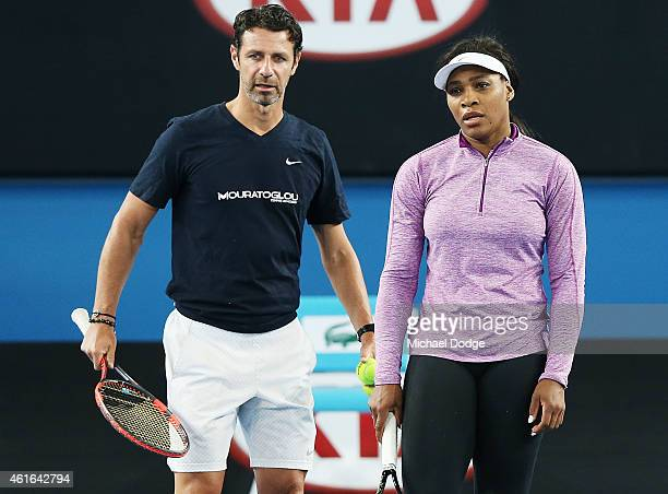 Serena Williams of the USA listens to coach Patrick Mouratoglou during a practice session ahead of the 2015 Australian Open at Melbourne Park on...