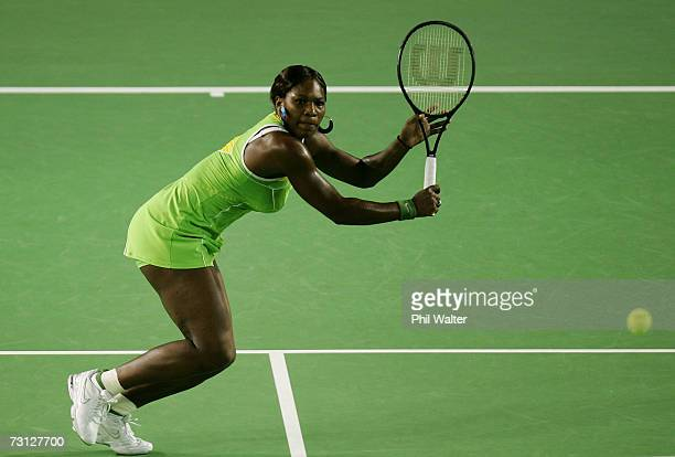 Serena Williams of the USA plays a backhand during her women's final match against Maria Sharapova of Russia on day thirteen of the Australian Open...