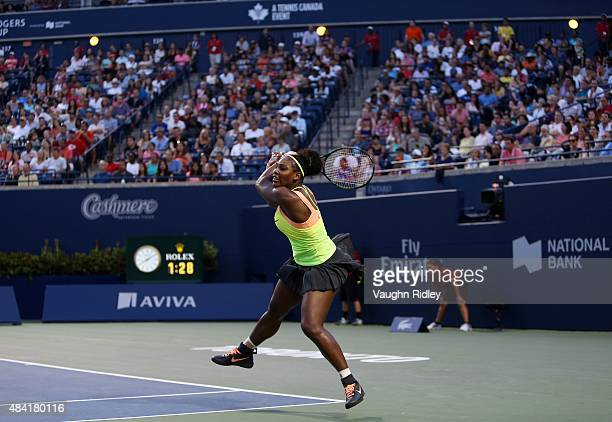 Serena Williams of the USA plays a shot against Belinda Bencic of Switzerland during Day 6 of the Rogers Cup at the Aviva Centre on August 15 2015 in...