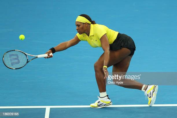 Serena Williams of the USA plays a shot during her match against Chantelle Scheepers during day two of the 2012 Brisbane International at Pat Rafter...
