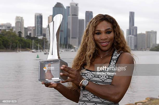 Serena Williams of the USA poses for a photo with the winners trophy after defeating Victoria Azarenka in the Womens final last night during day...