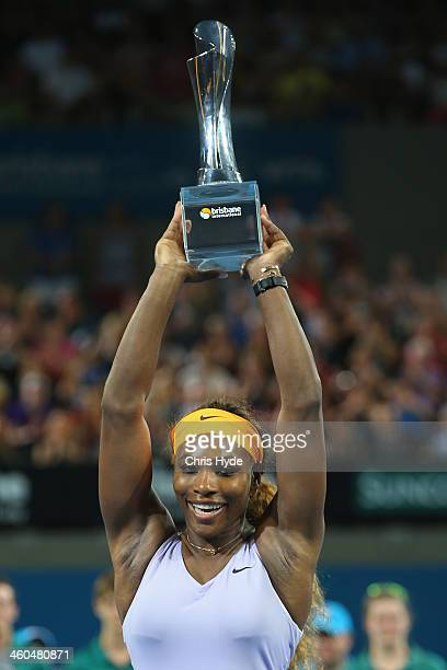 Serena Williams of the USA poses with the winners trophy after winning her finals match against Victoria Azarenka of Belarus during day seven of the...