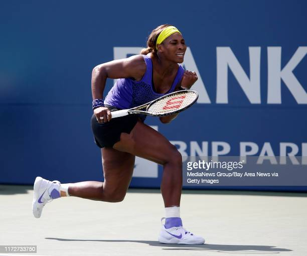 Serena Williams of the USA reacts after winning a point in the second set against Angelique Kerber of Germany during their tennis match finals at the...