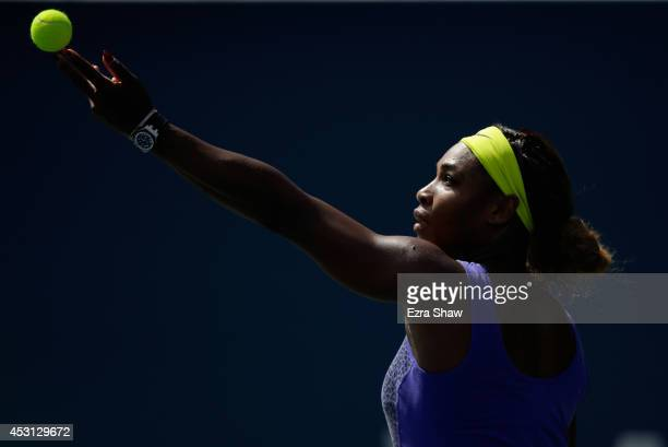 Serena Williams of the USA serves to Angelique Kerber of Germany in the finals of the Bank of the West Classic at the Taube Family Tennis Stadium on...