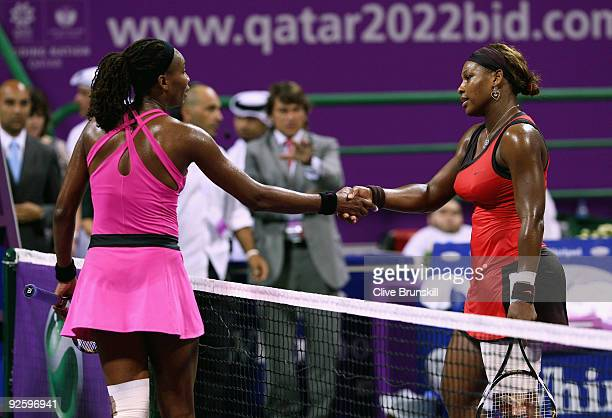 Serena Williams of the USA shakes hands at the net with Venus Williams of the USA after Serena's straight sets victory in the Women's final during...