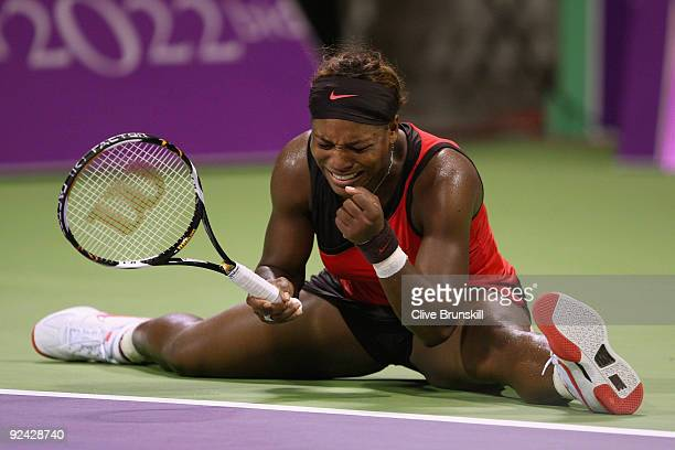 Serena Williams of the USA shows her frustration against Venus Williams of the USA in their round robin match during the Sony Ericsson Championships...