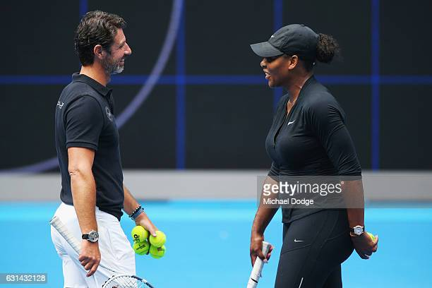 Serena Williams of the USA speaks to coach Patrick Mouratoglou during a practice session ahead of the 2017 Australian Open at Melbourne Park on...