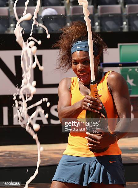 Serena Williams of the USA sprays champagne after her straight sets victory against Victoria Azarenka of Belarus in their final match during day...