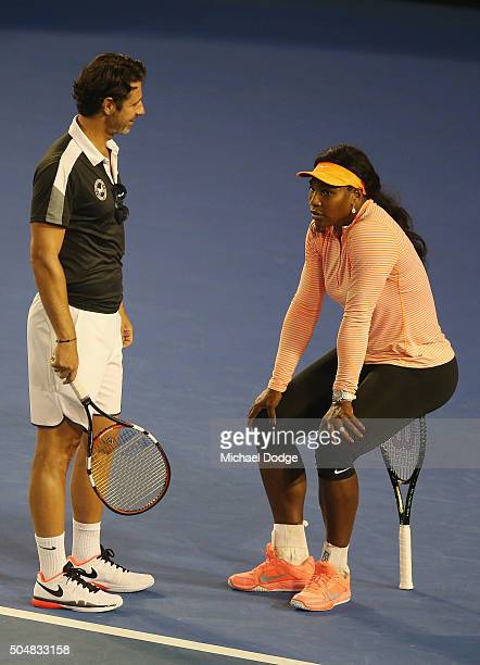 Serena Williams of the USA talks with coach coach Patrick Mouratoglou while sitting on her racquet during a practice session ahead of the 2016...