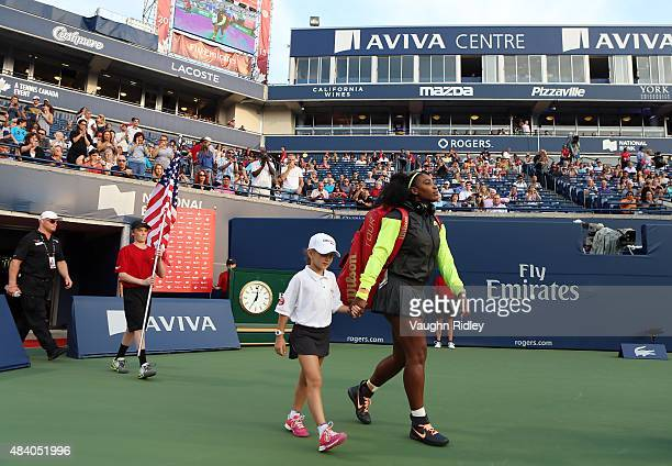 Serena Williams of the USA walks onto Centre Court for her match against Roberta Vinci of Italy during Day 5 of the Rogers Cup at the Aviva Centre on...