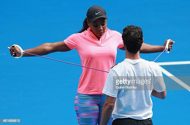 Serena Williams of the USA warms up with her coach with her coach Patrick Mouratoglou during a practice session ahead of the 2015 Australian Open at...