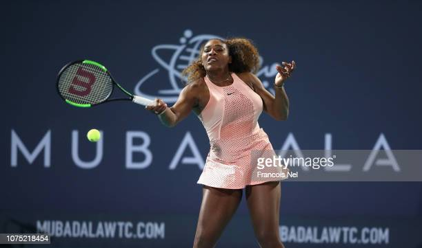 Serena Williams of United States in action against Venus Williams of United States during her women's singles match on day one of the Mubadala World...