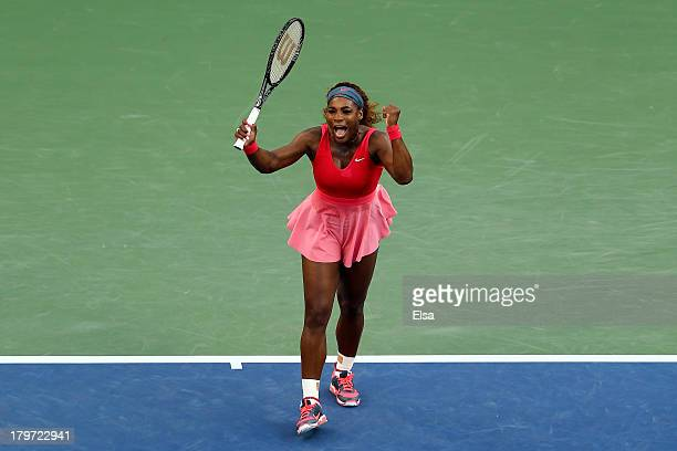 Serena Williams of United States of America celebrates winning her women's singles semifinal match against Na Li of China on Day Twelve of the 2013...