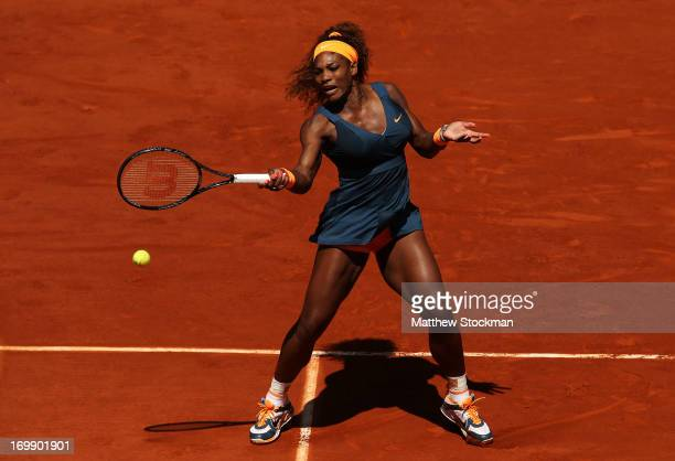 Serena Williams of United States of America plays a forehand during her Women's Singles match against Svetlana Kuznetsova of Russia on day ten of the...