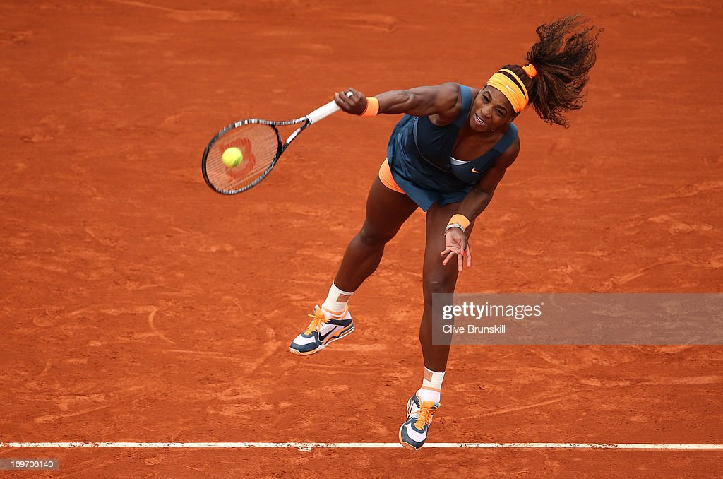 Serena Williams of United States of America serves during her Women's Singles match against Sorana Cirstea of Romania on day six of the French Open at Roland Garros on May 31, 2013 in Paris, France.