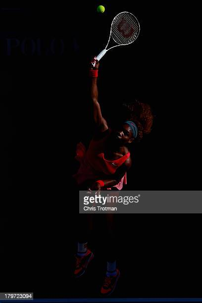 Serena Williams of United States of America serves during her women's singles semifinal match against Na Li of China on Day Twelve of the 2013 US...
