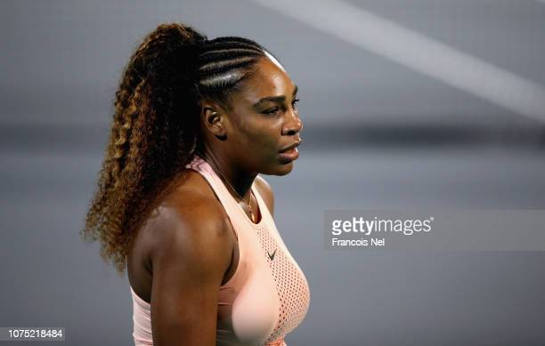 Serena Williams of United States reacts during her womens's singles match on day one of the Mubadala World Tennis Championship at International...