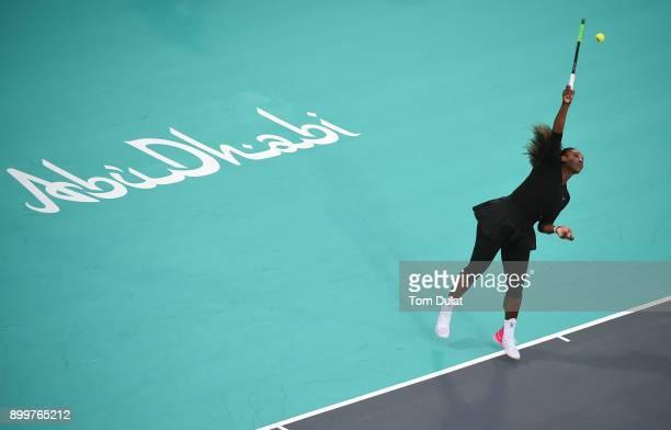 Serena Williams of United States serves against Jelena Ostapenko of Latvia during Ladies Final match on day three of the Mubadala World Tennis...