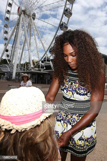 Serena Williams of United States sign an autograph at the Wheel of Brisbane in South Bank on day two of the Brisbane International on December 31...