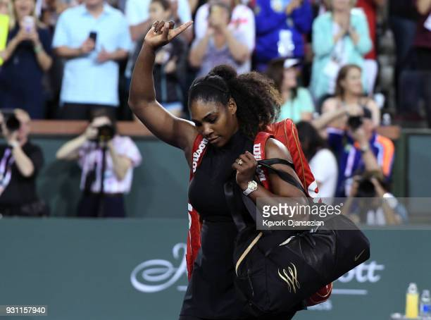 Serena Williams of United States waves to crowd after her loss to her sister Venus Williams during Day 8 of BNP Paribas Open on March 12 2018 in...