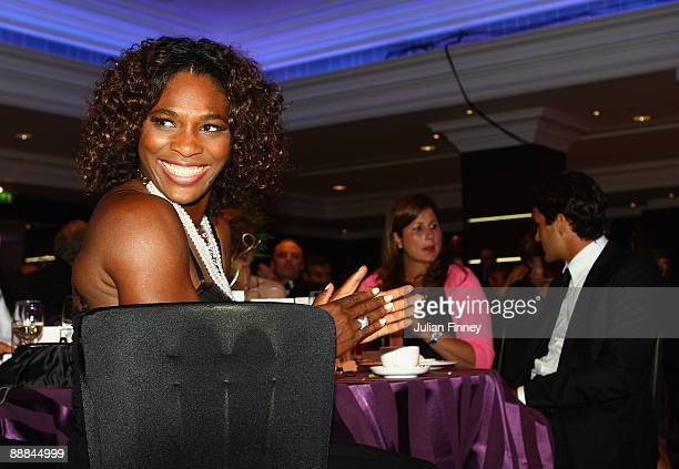 Serena Williams of United States with Roger Federer and his wife Mirka Federer at the Wimbeldon Winners Party at the Hotel Intercontinental on July 5...